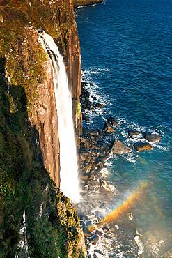 Kilt waterfall falling directly into the sea on the Isle of Skye, Inner Hebrides, Scotland, United Kingdom