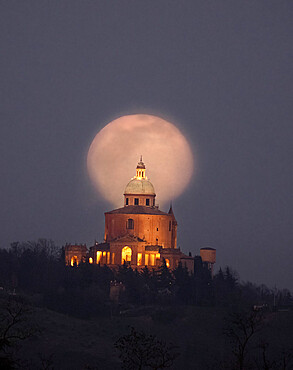 Moon rise behind the San Luca basilica, Bologna, Emilia Romagna, Italy