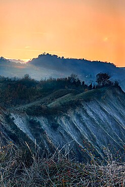 Orange sunset on badlands, Emilia Romagna, Italy, Europe
