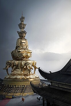 Golden summit Buddhist shrine gets his name from this huge golden statue of Puxian (Samantabhadra), Emeishan, Sichuan, China, Asia