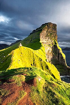 Sunset on Kallur Lighthouse on Kalsoy island, Faroe Islands, Denmark, Europe