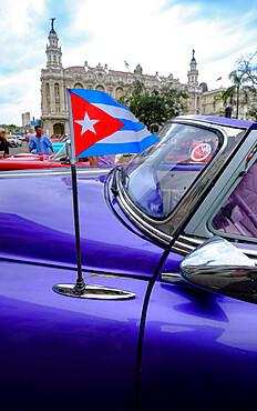 Cuban flag on antenna of antique car, Havana, Cuba