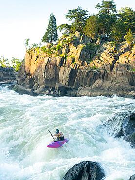 Ian Brown kayaks the Maryland side of Great Falls of the Potomac River. Maryland USA. MR