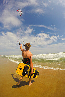 A kiteboarder heads out into the Atlantic Ocean off Cape Hatteras, North Carolina, USA. MR