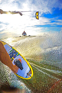 Photographer Skip Brown kiteboards next to Thomas Point Lighthouse on the Chesapeake Bay near Annapolis, MD USA. MR