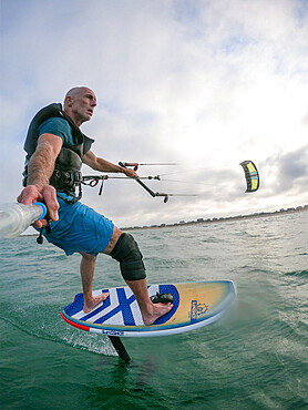 Photographer Skip Brown on his foiling kiteboard in the Atlantic Ocean off Nags Head NC USA. MR
