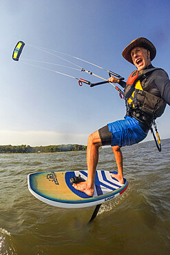 Photographer Skip Brown on his foiling kiteboard on the Chesapeake Bay near Annapolis, Maryland USA. MR