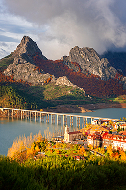 Riano cityscape at sunrise with mountain range landscape during Autumn in Picos de Europa national park, Spain