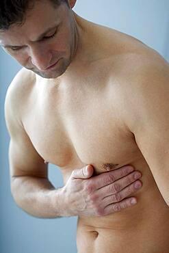Man with rib pain