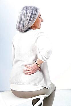 Lower back pain in elderly person