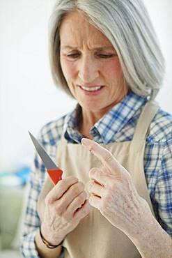 Elderly person in  kitchen