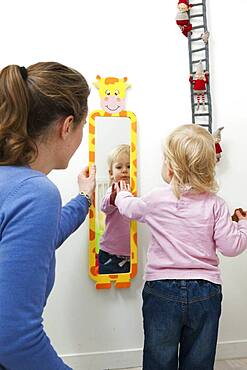 Child with mirror