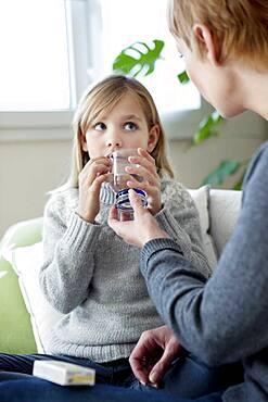 Child taking medication