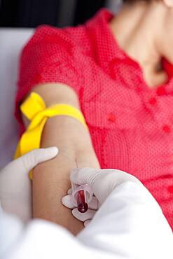 Blood specimen in a woman