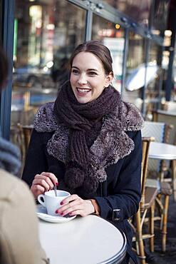 Women drinking coffe at a terrace.