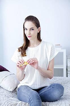 Woman taking contraceptive pill.