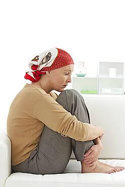 Portrait of a woman wearing a headscarf.
