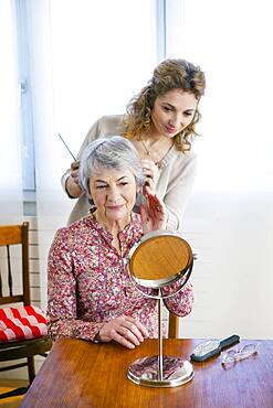Senior woman with her carer.