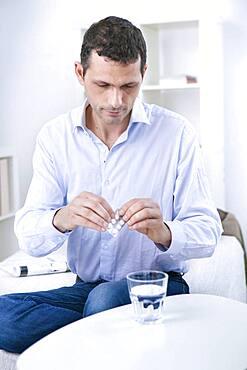 Man taking medicine.