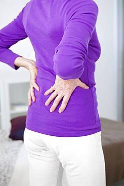 Senior woman with lumbar pain.