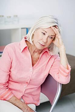 Sad senior woman.