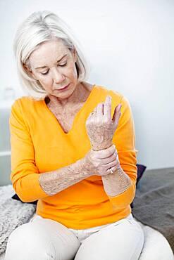 Senior woman with wrist pain.