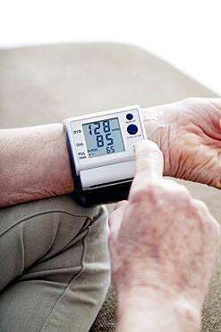 Senior woman measuring her blood pressure.