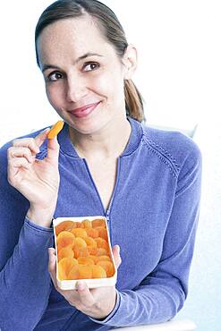 Woman snacking