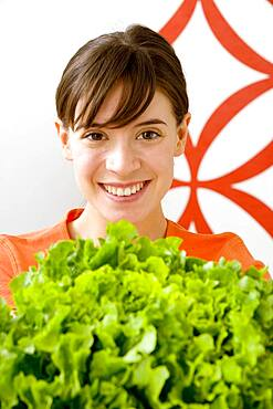 Woman eating raw vegetables