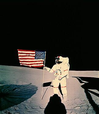 Astronaut with US flag on moon
