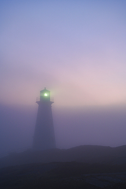 Cape Spear Lighthouse in early morning fog, St. John's, Newfoundland, Canada.