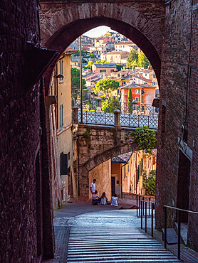 Perugia's Aqueduct street with its famous bridge as seen from an alley
