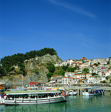 Tourist boats and the town of Parga in the background, Greece, Europe