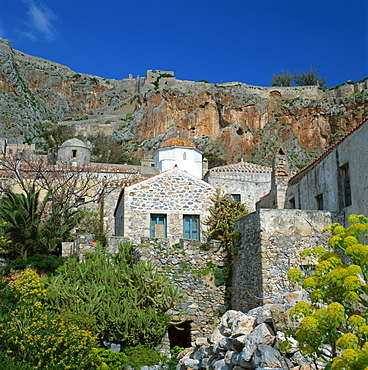 A church with cliffs behind at Monemvasia, known as the Gibraltar of Greece, Greece, Europe