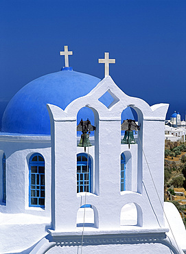 Close-up of white walls and bells in bell tower with blue dome behind at a church in Apollonia, on Sifnos, Cyclades, Greek Islands, Greece, Europe