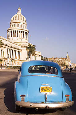 An old American car in front of the Capitolio in central Havana, Cuba, West Indies, Central America