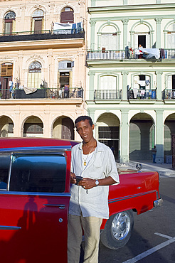 A Cuban man and his 1950's Chevy, Havana, Cuba, West Indies, Central America