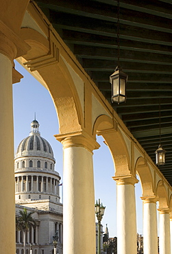 A view of the Capitolio seen through the arches of a colonial style arcade in central Havana, Cuba, West Indies, Caribbean, Central America