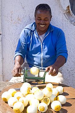 A Cuban man peeling oranges to sell, Havana, Cuba, West Indies, Central America