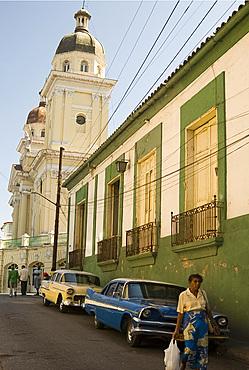 Vintage cars parked in an old street past vintage cars near the Catedral de la Asuncion, Santiago de Cuba, Cuba, West Indies, Central America