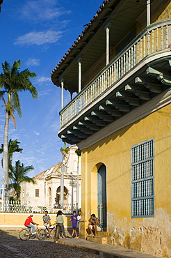Cubans out on the cobbled street next to the Casa Ortiz, Trinidad, Cuba, West Indies, Central America
