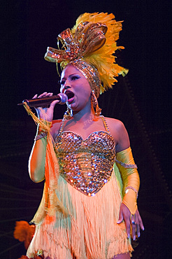 A colurfully attired singer at the Tropicana nightclubHavana, Cuba, West Indies, Central America