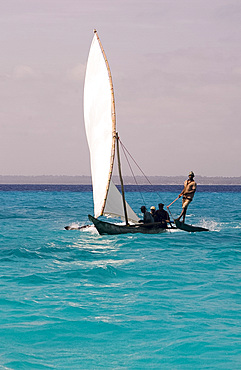A traditional wooden sailing dhow near Mnemba Island, Zanzibar, Tanzania, East Africa, Africa