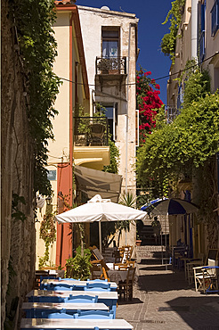 Traditional tables and chairs at Tamam Taverna on a backstreet in Hania, Crete, Greek Islands, Greece, Europe