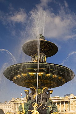 An ornate gilded fountain and statues in the Place de la Concorde, Paris, France, Europe