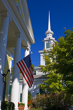 An American flag and the Presbyterian Church in Rensselaerville, New York State, United States of America, North America