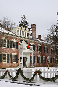 An imposing red brick house decorated for Christmas with wreaths and garlands, Woodstock, Vermont, New England, United States of America, North America