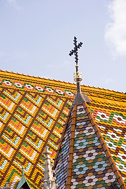 A detail of the colourful tiles on the roof of Matyas Church, Budapest, Hungary, Europe