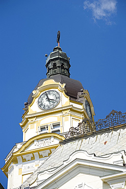 An ornate clock tower on the Town Hall, Pecs, Hungary, Europe