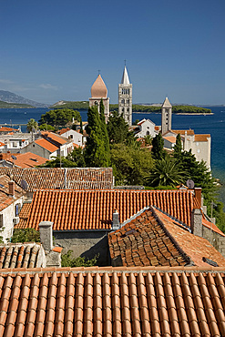 A view of the terracotta rooftops and medieval bell towers in Rab Town, island of Rab, Kvarner region, Croatia, Europe